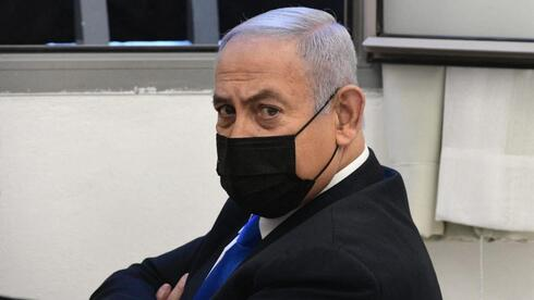 Prime Minister Benjamin Netanyahu appearing in the Jerusalem District Court in February where he pleaded not guilty to charges of corruption