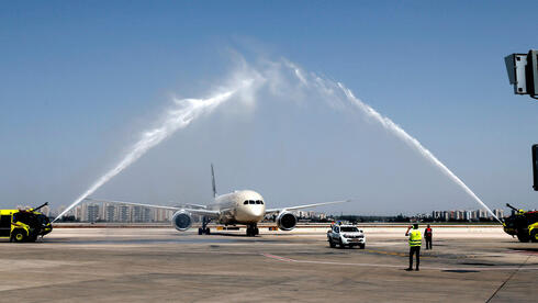 "A water salute welcomes an Etihad Airways Boeing 787-9 ""Dreamliner"" aircraft after landing upon arrival from the United Arab Emirates (UAE) at Israel's Ben Gurion Airport"