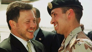 Jordan's King Abdullah II laughs with his half brother Prince Hamzah, right, shortly before the monarch embarked on a tour of the United States