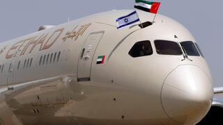 An Etihad Airways Boeing 787-9 'Dreamliner' aircraft displays Israeli and Emirati flags after landing at Israel's Ben Gurion Airport