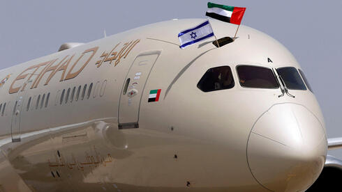 """n Etihad Airways Boeing 787-9 """"Dreamliner"""" aircraft displays Israeli and Emirati flags after landing upon arrival from the United Arab Emirates (UAE) at Israel's Ben Gurion Airpor"""