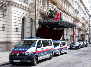 Austrian police outside the Vienna hotel hosting talks on renewing the Iran nuclear deal this month