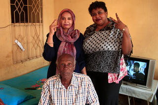 Amin Israil, the grandson of an Iraqi Jew who settled in Sudan and whose family later converted to Islam, with his daughter Salma, left, and Yosar Basha, another Sudanese woman of Jewish origin, at Israil's home in Wad Madani