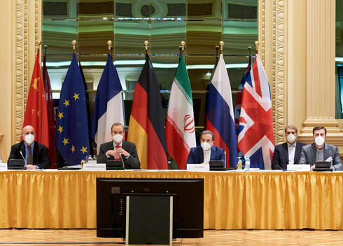 European External Action Service (EEAS) Deputy Secretary General Enrique Mora and Iranian Deputy at Ministry of Foreign Affairs Abbas Araghchi wait for the start of a meeting of the JCPOA Joint Commission in Vienna, Austria