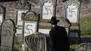 Strasbourg chief Rabbi Harold Abraham Weill looks at vandalized tombs in the Jewish cemetery of Westhoffen, west of the city of Strasbourg, eastern France
