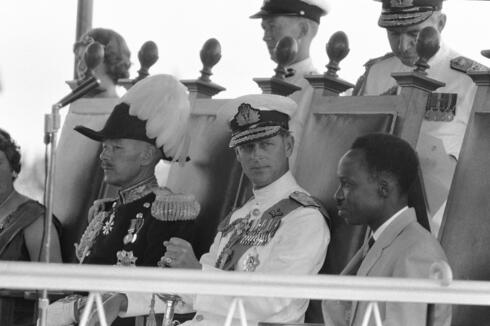 Prince Philip, center, looks at Tanganyika Prime Minister Julius Nyerere, right, during the ceremony to swear in the new Governor-General, at the Independence celebrations, in Dar-Es-Salaam, Tanganyika, Dec. 9, 1961