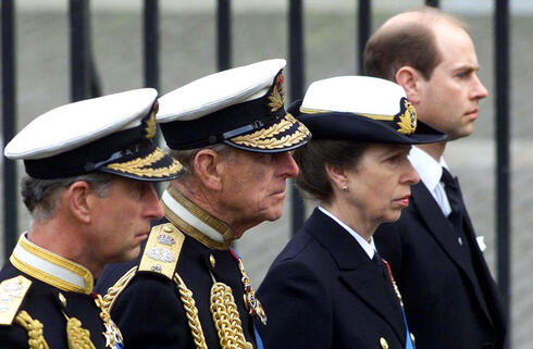 L-R: Prince Charles, Prince Philip, Princess Anne and Prince Edward follow the coffin of the Queen Mother en route to her funeral in Westminster Abbey, April 2002