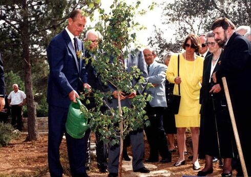Prince Philip planting a tree for his mother Princess Alice at Yad Vashem Holocaust Museum in Jerusalem in 1994