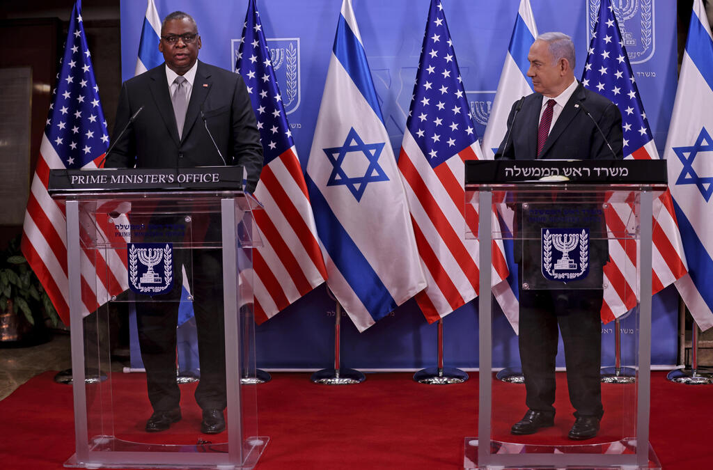 U.S. Defense Secretary Lloyd Austin, left, and Israeli Prime Minister Benjamin Netanyahu give statements after their meeting, at the prime minister's office, in Jerusalem