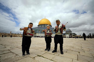Muslim kids play music at Temple Mount in Jerusalem's Old City during preparation for the holy Muslim month of Ramadan as COVID-19 restrictions ease around Israel, April 10, 2021
