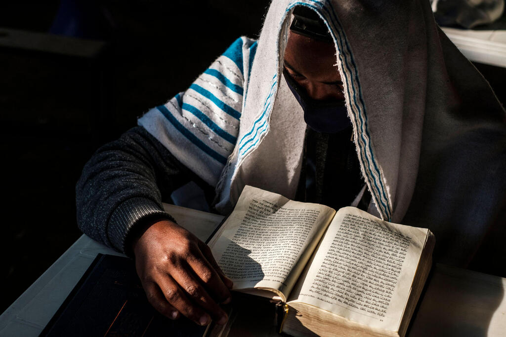 A member of the Ethiopian Jewish community attends a religious service at the synagogue of the community in the city of Gondar, Ethiopia