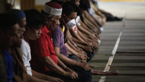 Filipino Muslim men attend prayers on the first day of Ramadan, amid the coronavirus disease (COVID-19) pandemic, at Golden Mosque in Quiapo, Manila, Philippines