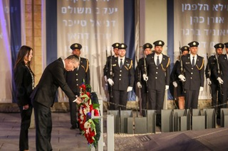 Laying of the wreath in the Knesset building in Jerusalem while the names of the fallen are projected in the background