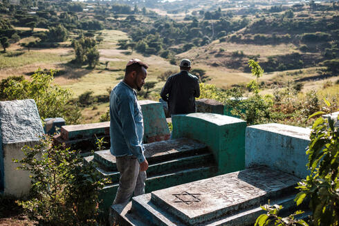 Sitotaw Alene (R) and Adamu Mengistu, leaders of the Ethiopian Jewish community, visit the cemetery of the community in the outskirts of the city of Gondar, Ethiopia