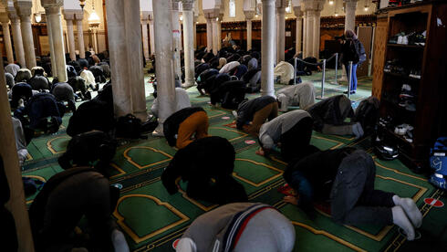 People pray at the Grand Mosquee de Paris on April 13, 2021 hours before the start of the Muslim holy month of Ramadan in France.