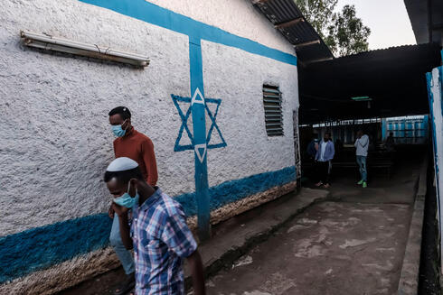 Members of the Ethiopian Jewish community leave the building after attending a religious service at the synagogue of the community in the city of Gondar, Ethiopia
