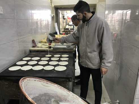 Noor Abu Sbaih makes qatayef at Al-Najah Sweets in Jerusalem's Old City