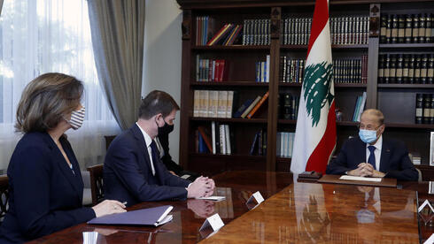 Lebanese President Michel Aoun, right, meets with U.S. Undersecretary of State for Political Affairs David Hale