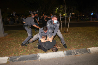 Police arrest a protester in Jaffa on Sunday night