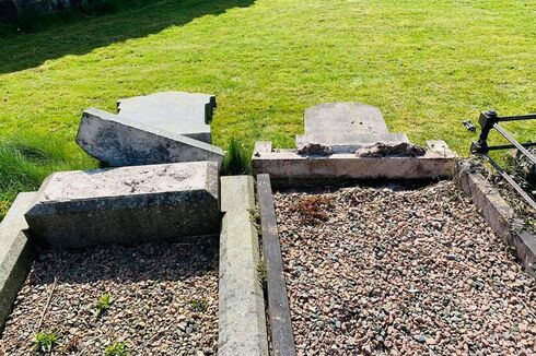 The damaged Jewish graves at the Belfast City Cemetery in Northern Ireland