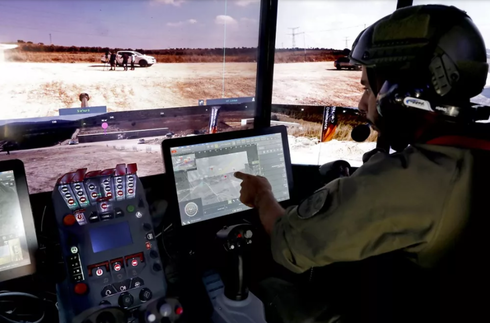 Illustrative: A Rafael Advanced Defense Systems employee operates systems of the Carmel project, a new combat vehicle, in Elkayim in northern Israel on August 4, 2019