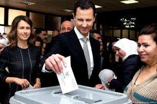Syrian President Bashar al-Assad casts a ballot in a presidential election