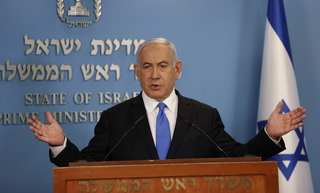 Prime Minister Benjamin Netanyahu speaking to reporters in Jerusalem on Tuesday
