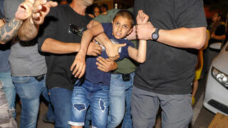 police detain a boy as Israeli left wing protesters and local residents demonstrate against right wing groups attempt to purchase property in the quarter