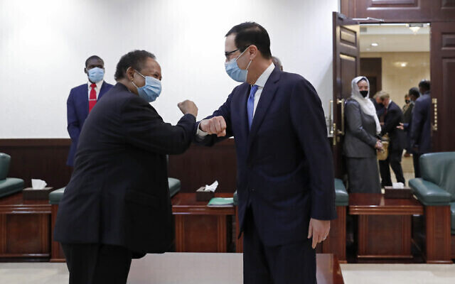 Former US Treasury Secretary Steven Mnuchin (L) and Sudanese Justice Minister Nasredeen Abdulbari sign the Abraham Accords in Sudan in January 2021