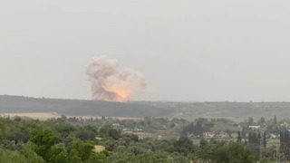 An explosion is seen at a rocket production facility in central Israel on April 20
