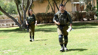IDF troops conducting a search of the area after a Syrian missile exploded over southern Israel early Thursday