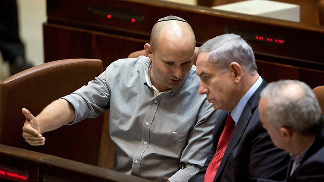 Naftali Bennett and Benjamin Netanyahu speaking during a Knesset session before the two fell out