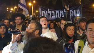 Haredi youths participating in a marching with the extreme-right Lehava group in Jerusalem on Thursday