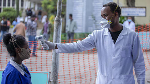 People have their temperatures checked at the Zewditu Memorial Hospital in Addis Ababa, Ethiopia,