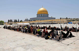 Muslim worshipers praying near Al-Aqsa Mosque on Jerusalem's Temple Mount