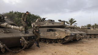 Israeli tanks deployed along the Gaza border after rockets were fired at Israeli communities over the weekend