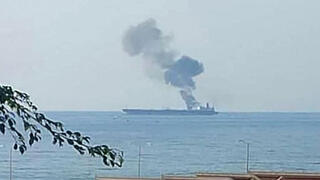 A handout picture released by the official Syrian Arab News Agency (SANA) on April 24, 2021, shows smoke billowing from a tanker off the coast of the western Syrian city of Baniyas