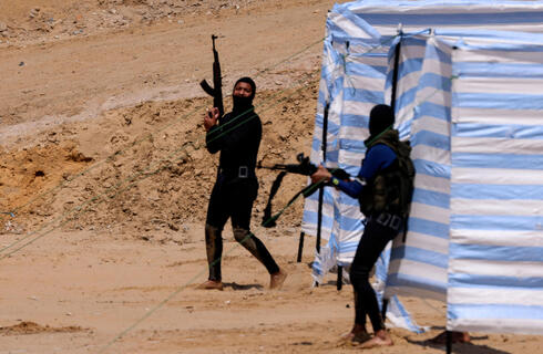 Palestinian militants training on a Gaza beach at the weekend