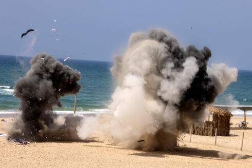 Hamas fires a practice rocket out to sea from Gaza on Saturday after dozens of rockets were launched at Israel overnight