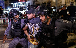 Border Police officers arrest a Palestinian protester during clashes at the Damascus Gate in Jerusalem