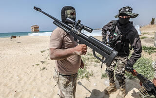 Palestinian militants training on a Gaza beach on Saturday