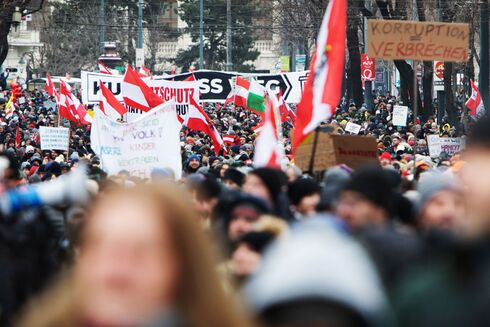 Demonstrators protest coronavirus restrictions in Austria last week