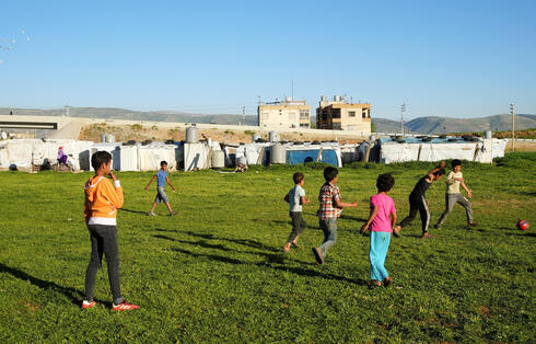 Syrian refugee youths play together at an informal tented settlement in Bar Elias, in the Bekaa Valley, Lebanon April 22, 2021