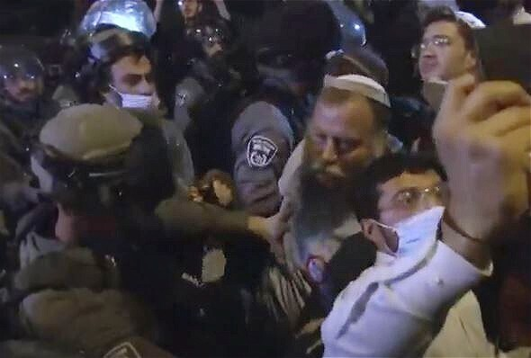 Lehava leader Bentzi Gopstein scuffles with police as they break up his extreme-right rally in Jerusalem last week