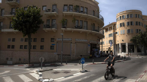 A man rides a bicycle in the Jaffa neighborhood of Tel Aviv, Israel, Wednesday, April 21, 2021