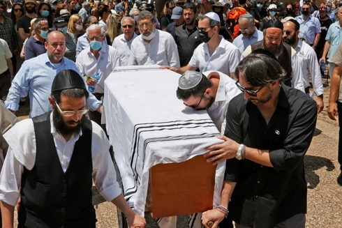 Alber Elbaz was laid to rest in Holon on Wednesday