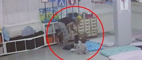 video footage shoeing one of hte kindergarten staffers slapping a toddler