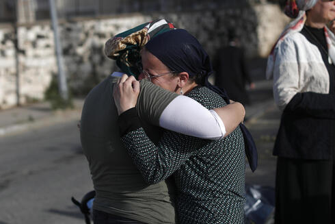 Family members mourn the passing of Yehuda Rubin —one of 45 people who have lost their lives in the Mount Meron stampede