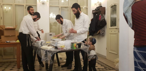 Lev Chabad members preparing food for those caught up in the disaster
