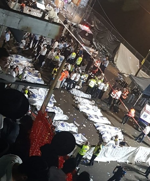 Dozens of body bags lying on the ground shortly after the tragic event